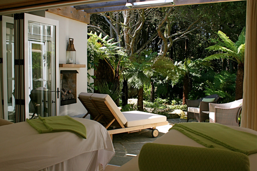 Kauri Cliffs Spa massage rooms amongst the lush native plantings