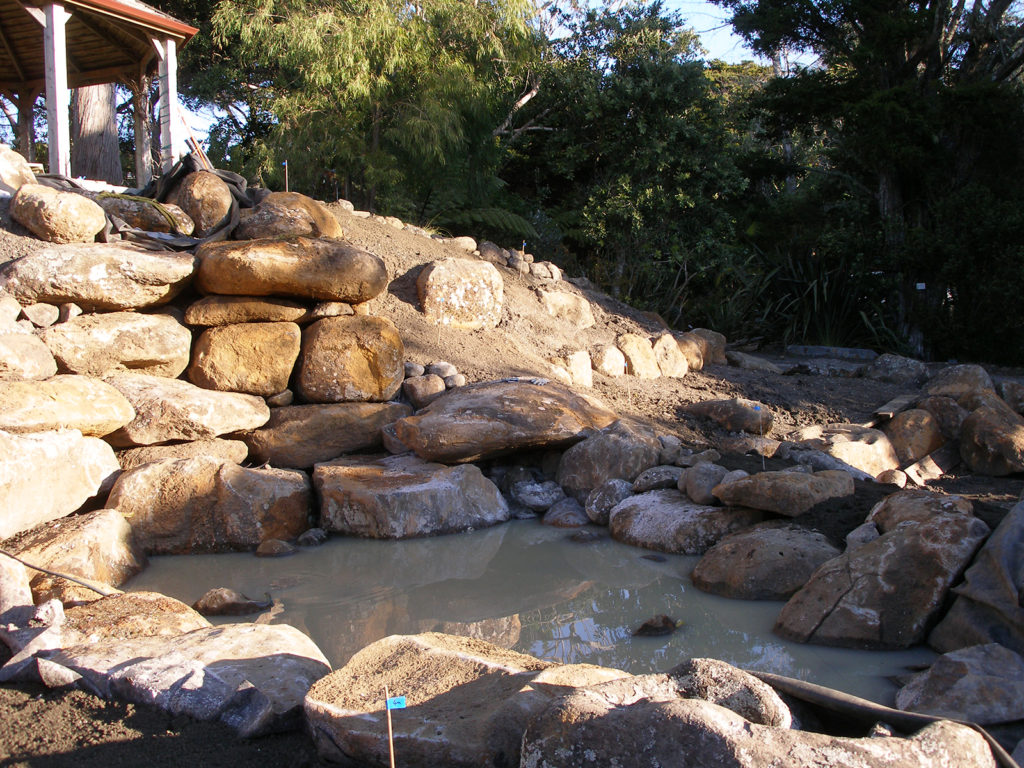 early stages of rocky waterfall design by hawthorn landscapes kerikeri