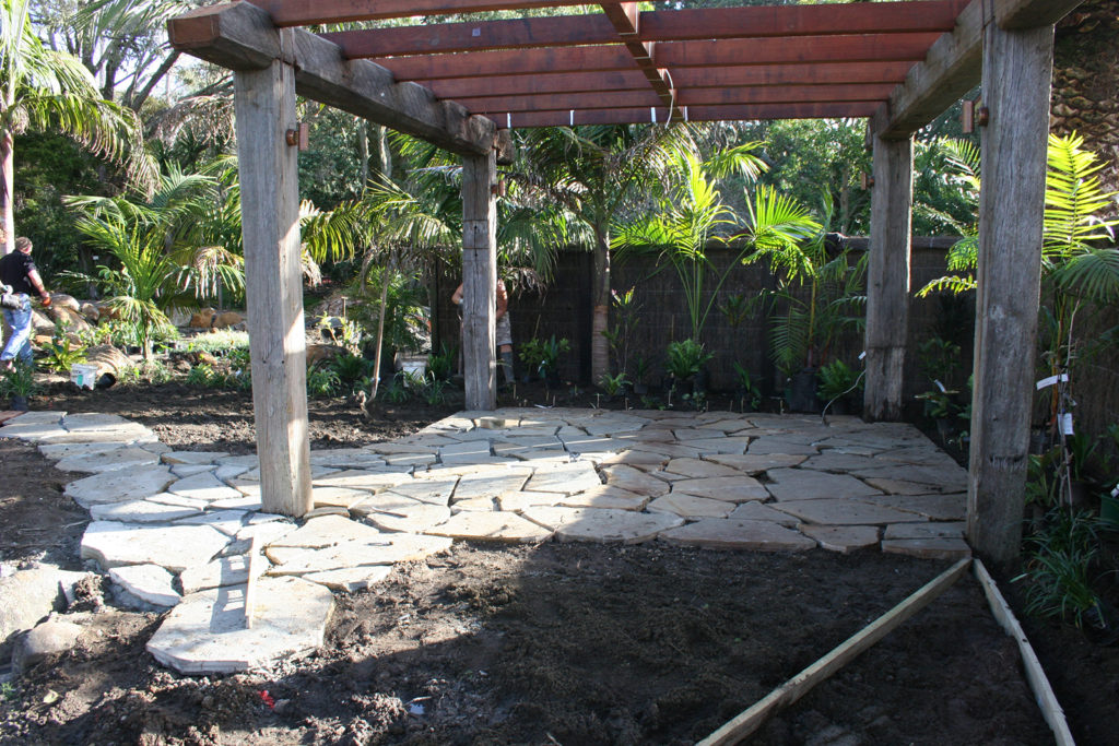 laying down the outdoor seating area stones