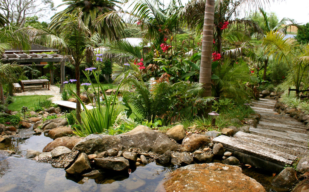 railway sleeper steps and pond at sanctuary in the cove